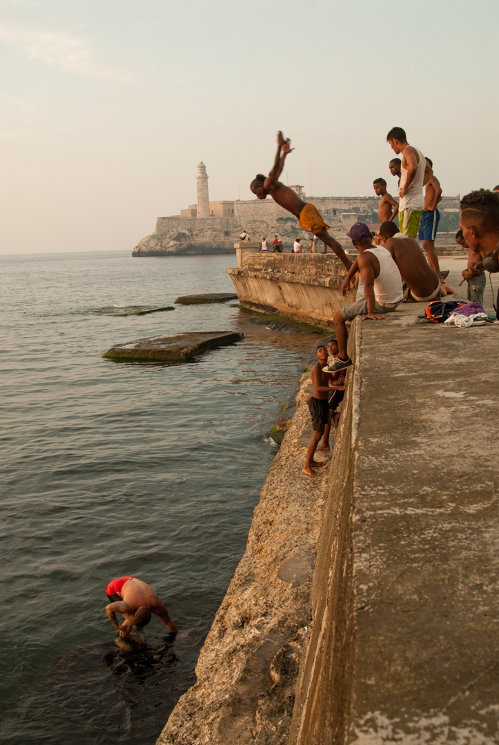 The Malecon is the front porch of Havana, a place for locals to escape the heat of their homes during summer months. On a typical day there, you can find families enjoying the afternoon, young people out on romantic dates and groups of teenagers dancing Regaetton. This photo was part of an article that Britt wrote for National Geographic Travel India on music and dance in Cuba.