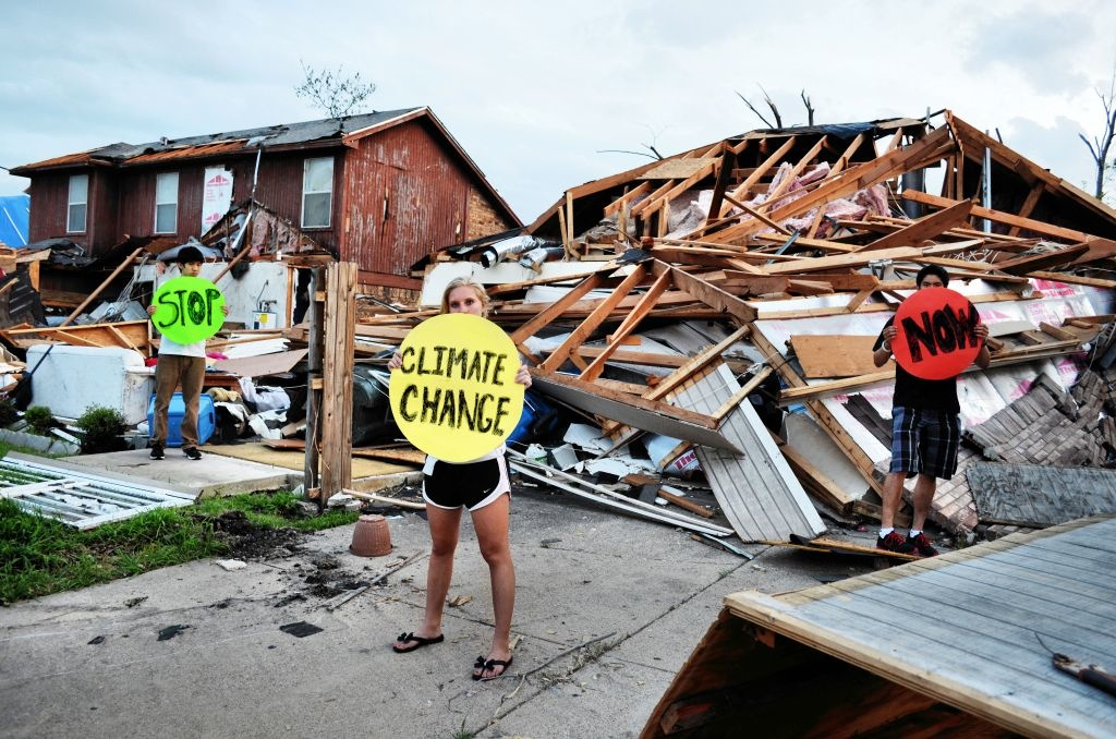 High school students hold dots in Lancaster, Texas where tornadoes wrecked the town. Research shows that climate change may increase conditions that lead to tornadoes. Photo: 350.org